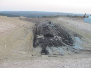 Test pit at tar sands strip mine