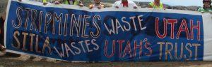 """banner """"Stripmines waste Utah, SITLA wastes Utah's Trust"""""""