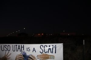 night view of tar sands factory and banner